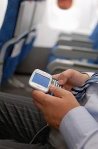 cell phone on a plane, image credit BigStock