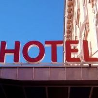 Hotel sign - Hotel Photo Deception & How To Fight Back