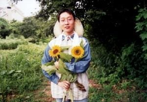 WWOOF Host in Japan With Sunflowers  - photo courtesy of WWOOF
